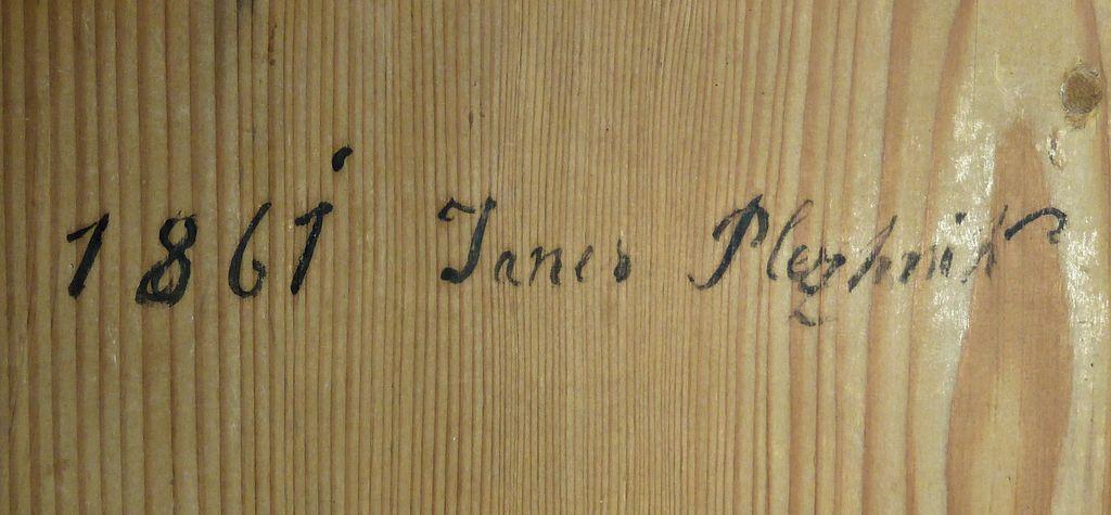 Letnica 1861 in podpis Janeza Plečnika na prižnici v cerkvi sv. Barbare na Ravniku pri Hotedršici (foto: Simona Kermavnar)