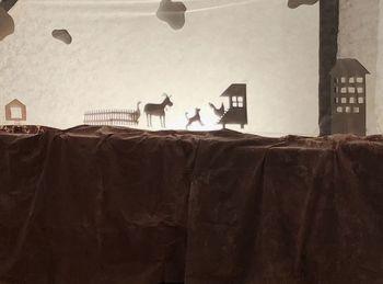 Kužek Postružek in senčno gledališče