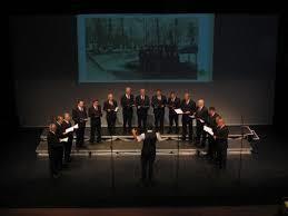Moški pevski zbor Rožmarin na dobrodelnem koncertu in reviji pevskih zborov