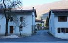 Preplastitev odseka ceste v vasi Robič.