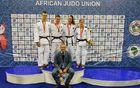 Dobitniki medalj s trenerjem Ruslanom Yankovskim