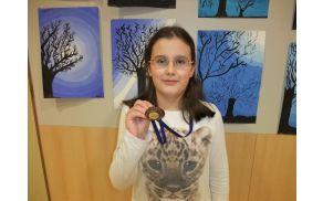 Tajda Tomelj  z bronasto medaljo