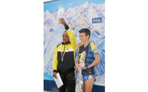Najboljša tekača Gorskega teka na Vogel Azaerya Teklay in Urša Trobec. Foto: Roman Pekovec