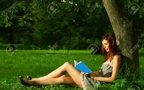 504_1497680068_11301772-beautiful-girl-reading-under-the-tree-stock-photo.jpg