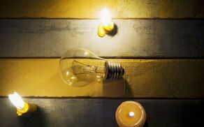 7411_1523951688_no-electricity-makes-electrical-equipment-useless-candle-light-shine-incandescent-bulb-57239667.jpg