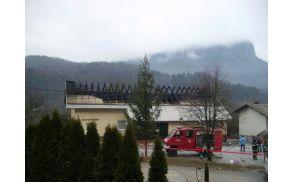Požar na strehi doma na Bohinjski Beli.